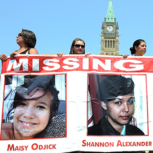 Participants of the Women's Worlds 2011 congress take part in a rally on Parliament Hill in solidarity with missing and murdered aboriginal women in Ottawa on Tuesday, July 5, 2011. (Sean Kilpatrick/CP)