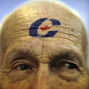 Supporter George Feltham sports the party logo during a rally for Conservative leader and Canada's Prime Minister Stephen Harper (not pictured) in Guelph, Ontario October 11, 2008. Canadians will head to the polls in a federal election on October 14. (Chris Wattie/Reuters)