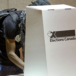 A Canadian prepares his ballot at a polling center October 14, 2008 in  St. Laurent, Quebec.  Canada is the first major economy to go to the polls since the start of a global financial meltdown, to be followed by a US presidential election November 4. Rogerio Barbosa/AFP/Getty Images