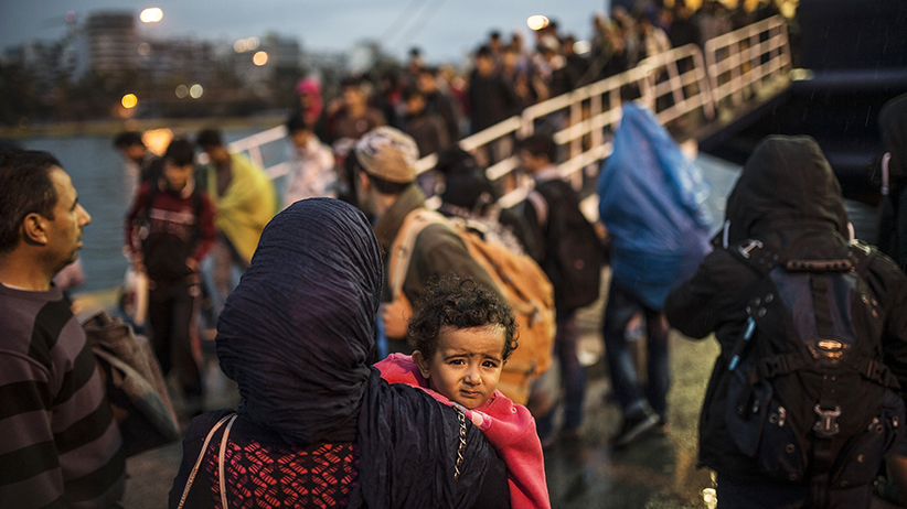 Refugees are seen at the port after arriving in Athens, Greece on September 24, 2015. (Ozge Elif Kizil/Anadolu Agency/Getty Images)