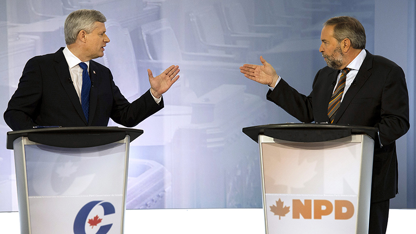 Conservative leader Stephen Harper, left, exchanges words with NDP leader Tom Mulcair during the French language leaders debate on Thursday in Montreal. (Adrian Wyld/CP)