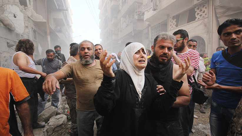 ALEPPO, SYRIA - SEPTEMBER 20 :  Syrian people carry wounded ones to hospital after Assad Regime Forces stage an airstrike to opposition controlled Muvasalat district of Aleppo, Syria on September 20, 2015. (Mamun Ebu Omer/Anadolu Agency/Getty Images)