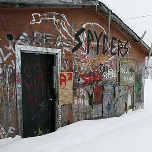 An abandoned house, which has been taken over by some teens and is used as a clubhouse  for pool and Texas Hold Em poker, on the Pikangikum First Nation, Friday, January 5, 2007. Pikangikum First Nation is a remote-access community located on Pikangikum Lake, approximately 100 km northwest of Red Lake, Ont. Half of the 430 homes are falling apart and unfit to live in, yet continue to be occupied. Ninety per cent don't have running water or indoor toilets.  (John Woods/CA)