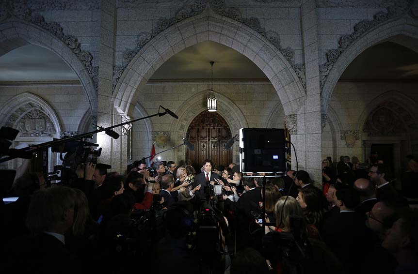 Liberal leader Justin Trudeau speaks to journalists in the foyer of the House of Commons on Parliament Hill in Ottawa April 15, 2013.   (Chris Wattie/Reuters)