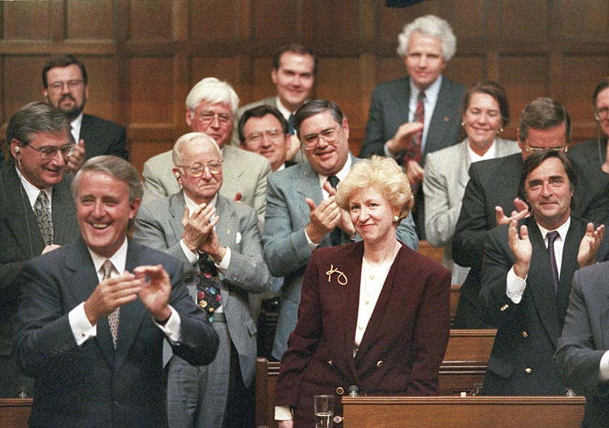 Kim Campbell, Leader of the Conservative Party and Prime Minister designate is given a standing ovation in the House of Commons by Prime Minister Brian Mulroney and other members of the government on June 16, 1993. (Tom Hanson/CP)