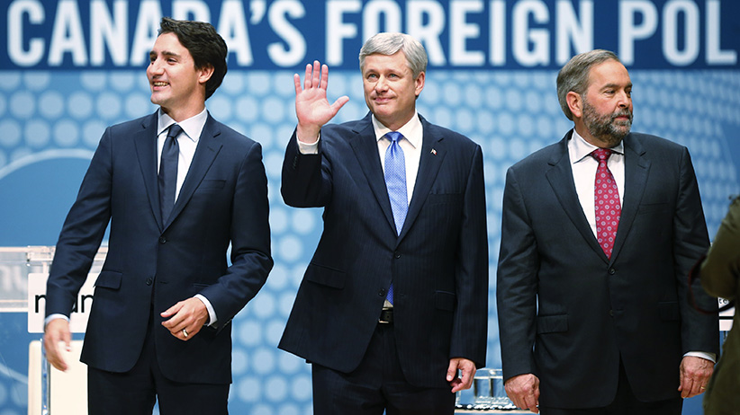 Liberal leader Justin Trudeau, Conservative leader and Prime Minister Stephen Harper and New Democratic Party (NDP) leader Thomas Mulcair (L-R) talk before the Munk leaders' debate on Canada's foreign policy in Toronto, Canada September 28, 2015. Canadians go to the polls in a federal election on October 19, 2015. (Mark Blinch/Reuters)