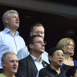 Conservative Leader Stephen Harper and his family sing the national anthem as the Toronto Blue Jays prepare to take on the Cleveland Indians during American League baseball action in Toronto on Monday, August 31, 2015. THE CANADIAN PRESS/Frank Gunn