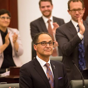 Alberta Finance Minister Joe Ceci, centre, receives a round of appause after delivering the 2015 provincial budget at the Legislative Assembly in Edmonton on Tuesday, Oct. 27, 2015. THE CANADIAN PRESS/Topher Seguin