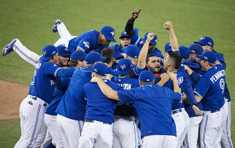 Members of the Toronto Blue Jays celebrate their series win over the Texas Rangers during game five American League Division Series baseball action in Toronto on Wednesday, October 14, 2015. THE CANADIAN PRESS/Darren Calabrese