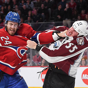 Jarred Tinordi #24 of the Montreal Canadiens fights with Cody McLeod #55 of the Colorado Avalanche in the NHL game at the Bell Centre on October 18, 2014 in Montreal, Quebec, Canada. (Francois Lacasse/NHLI/Getty Images)