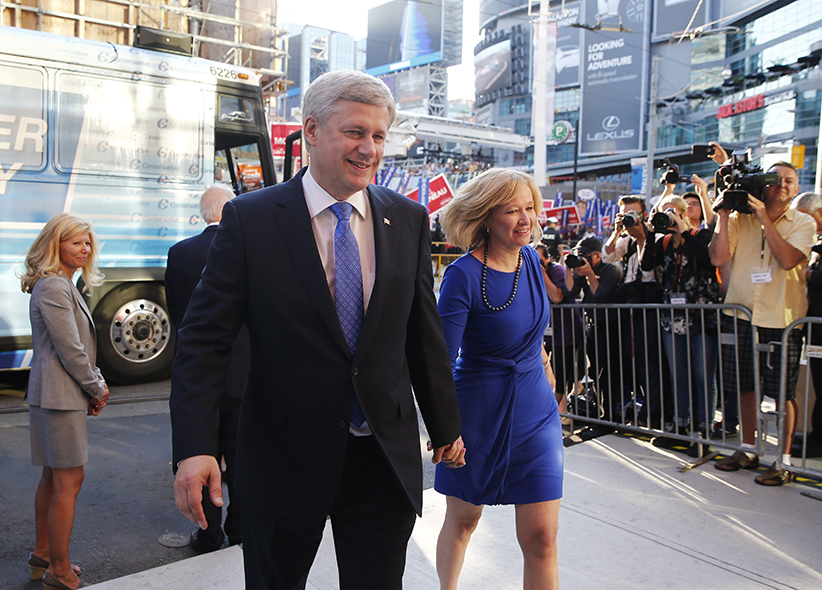 Canada's Conservative Prime Minister Stephen Harper arrives with his wife Laureen (R) at the venue for the Maclean's national leadership debate in Toronto August 6, 2015. Canadians go to the polls on October 19, 2015.  (Mark Blinch/Reuters)