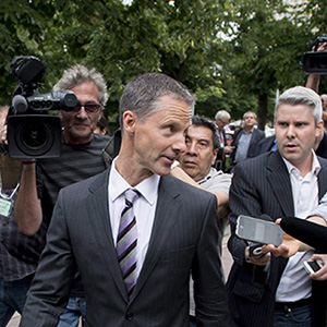 Nigel Wright, former Chief of Staff to Prime Minister Stephen Harper, leaves the courthouse in Ottawa after his first day of testimony in the trial of former Conservative Senator Mike Duffy on Wednesday, Aug. 12, 2015. Duffy is facing 31 charges of fraud, breach of trust, bribery, frauds on the government related to inappropriate Senate expenses. (Justin Tang/CP)