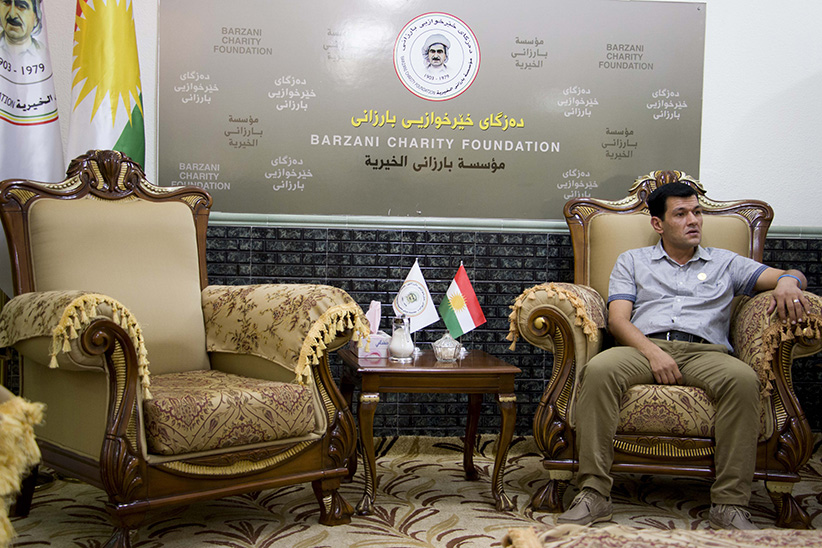 Abdullah Kurdi sits in the head office of the Barzani Charity Foundation, the main, government-linked NGO in Iraq's Kurdistan Region.   (Photograph by Adnan Khan)