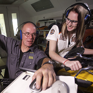 Manitoba Institute of Trades and Technology (MITT) motorsport instructor Geoff Ives assists student Ruth-Anne Klassen in the motorsport program Thursday, September 24, 2015.  (Photograph by John Woods)