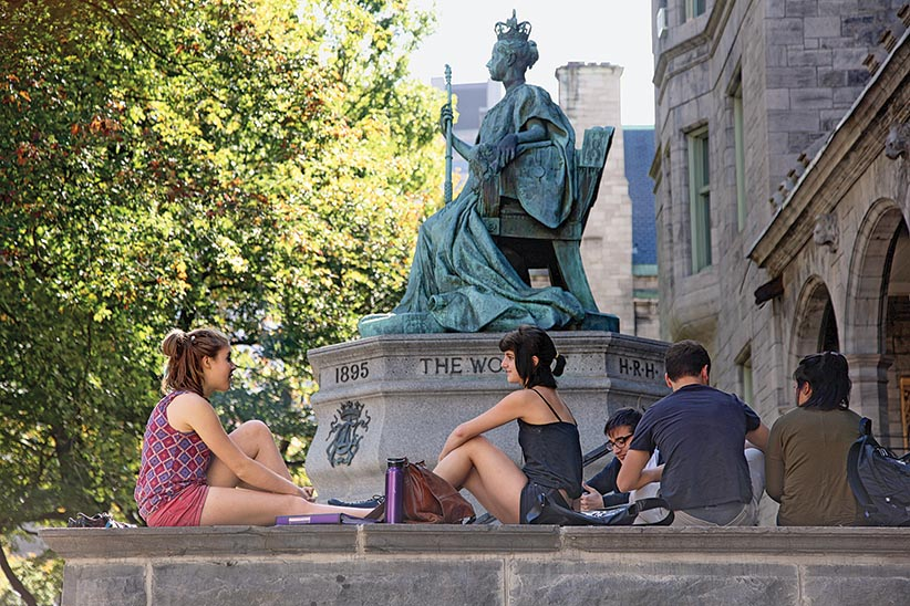 Students sit outside at McGill University in Montreal. (Photograph by Roger LeMoyne)