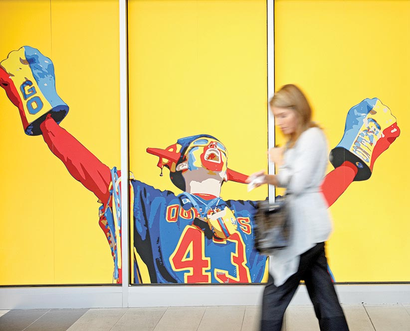 QUEEN'S UNIVERSITY - September 28, 2010 - A mural of a cheering fan greets a passerby at the Queen's Centre which houses the campus's athletics and recreational facilities at Queen's University in Kingston. (Photograph by Yvonne Berg)