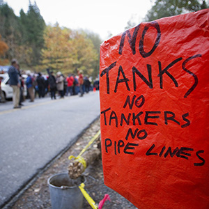 An anti-oil tanker sign is pictured near a demonstration against the proposed Kinder Morgan pipeline on Burnaby Mountain in Burnaby, British Columbia November 17, 2014. Kinder Morgan Energy Partners LP said on November 14, 2014 it would resume preliminary work on its Trans Mountain pipeline after a British Columbia court granted an injunction against protesters blocking work crews in the Vancouver suburb of Burnaby. (Ben Nelms/Reuters)