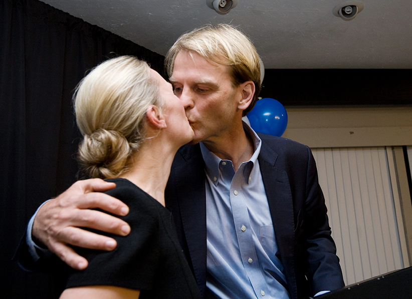 Chris Alexander, Conservative candidate for Ajax-Pickering, right, gives his wife Hedvig a kiss at a post- election gathering at his home in Ajax, Ont., on Monday, Oct. 19, 2015. Alexander lost his seat. (Peter Redman/CP)