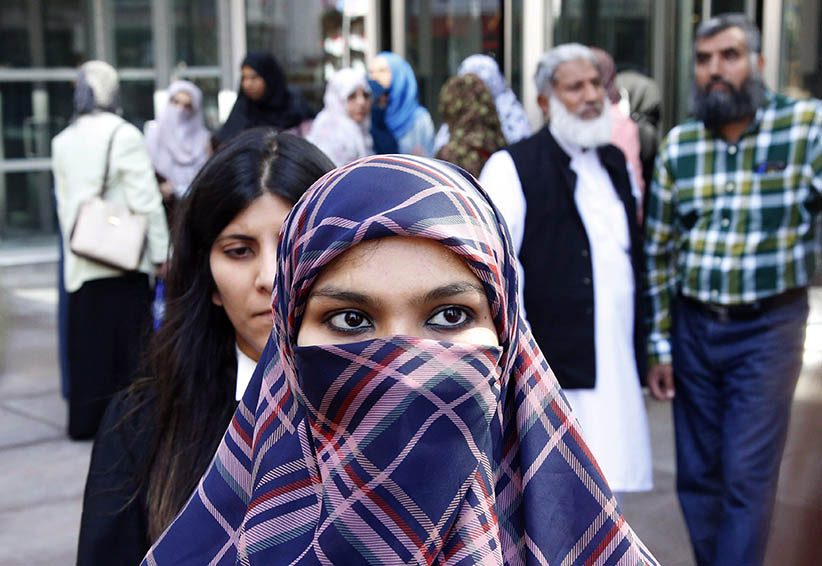 Zunera Ishaq talks to reporters outside the Federal Court of Appeal after her case was heard on whether she can wear a niqab while taking her citizenship oath, in Ottawa on Tuesday, September 15, 2015. (PATRICK DOYLE/CP)