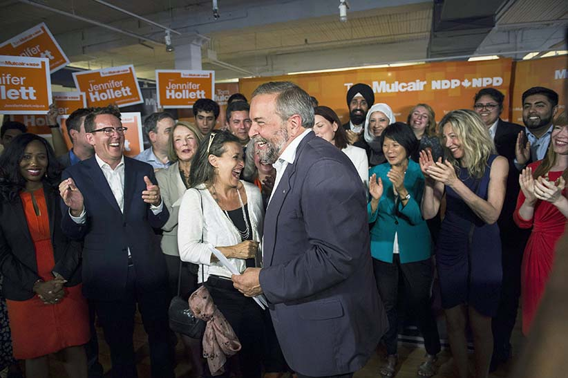 NDP Leader Thomas Mulcair Mulcair gathers with NDP candidates after speaking at a press conference in Toronto on Thursday, August 6, 2015.  (Aaron Vincent Elkaim/CP)