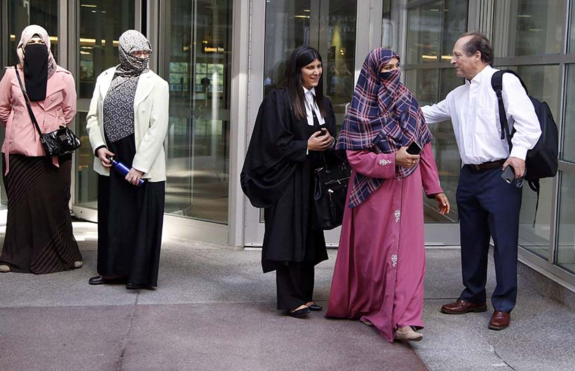 Zunera Ishaq, second from right, leaves the Federal Court of Appeal after her case was heard on whether she can wear a niqab while taking her citizenship oath, in Ottawa on Tuesday, September 15, 2015. (PATRICK DOYLE/CP)