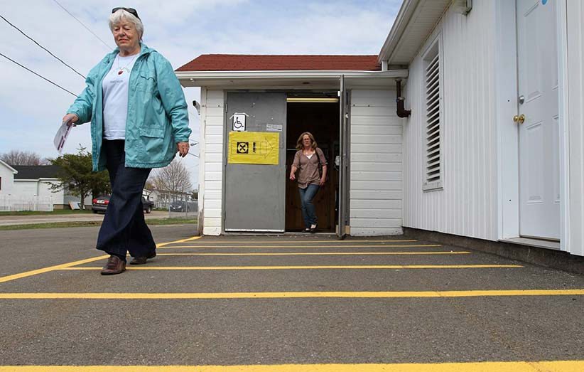 People leave a polling station in Point-du-Chene, New Brunswick as Canada goes to the polls for the federal election on Monday May 2, 2011. (Cole Burston/CP)