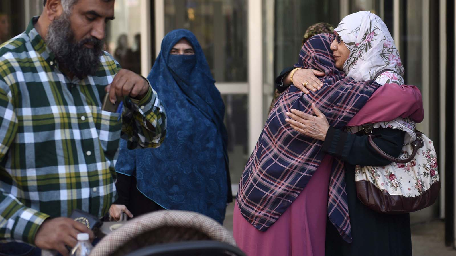 Zunera Ishaq (second from right) is embraced by her friend Nusrat Wahid after the Federal Court of Appeal overturned a ban on the wearing niqabs at citizenship ceremonies, in Ottawa on Tuesday, Sept. 15, 2015. (Justin Tang/CP)