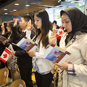 Oct 6 2015--Vancouver BC--Citizenship ceremony: New Canadians take the citizenship oath during a ceremony in Vancouver. (Photographs by Brian Howell)