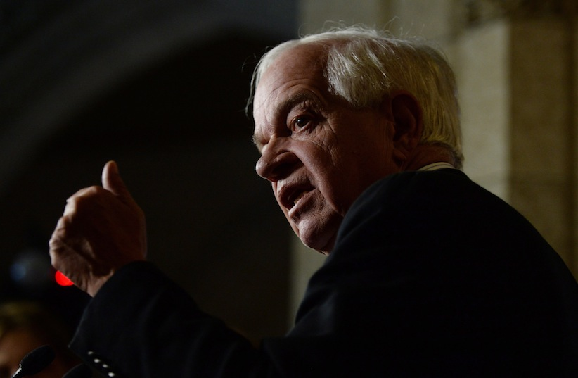 Minister of Immigration, Refugees and Citizenship John McCallum speaks to reporters in the foyer of the House of Commons on Parliament Hill in Ottawa on Monday, November 9, 2015. THE CANADIAN PRESS/Sean Kilpatrick