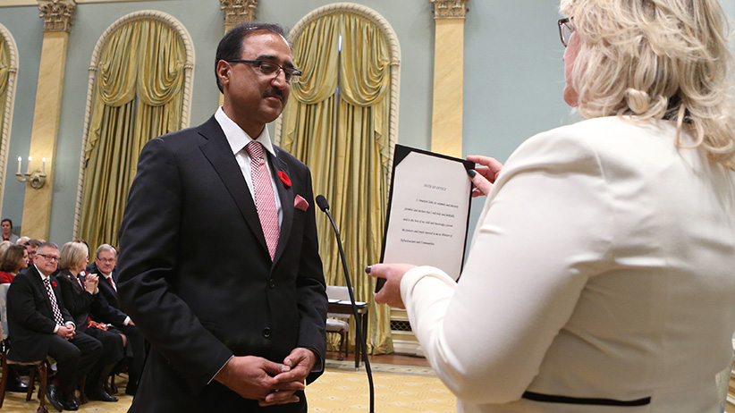 Canada's new Infrastructure and Communities Minister Amarjeet Sohi is sworn-in during a ceremony at Rideau Hall in Ottawa November 4, 2015. REUTERS/Chris Wattie  - RTX1URQK