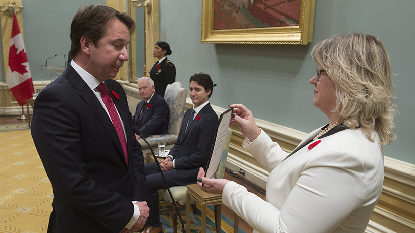 Governor General David Johnston and Prime Minister Justin Trudeau look on as Scott Brison is sworn in as President of the Treasury Board during ceremonies at Rideau Hall Wednesday Nov.4, 2015 in Ottawa. THE CANADIAN PRESS/Adrian Wyld