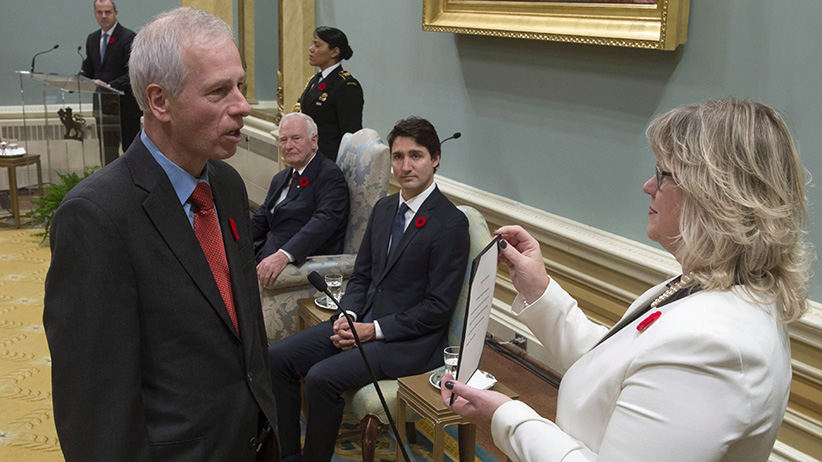 Governor General David Johnston and Prime Minister Justin Trudeau look on as Stephane Dion is sworn in as Minister of Foreign Affairs during ceremonies at Rideau Hall Wednesday Nov.4, 2015 in Ottawa. THE CANADIAN PRESS/Adrian Wyld