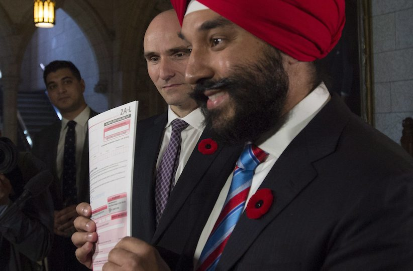 Minister of Families, Children and Social Development Jean-Yves Duclos looks on as Innovation, Science and Economic Development Minister Navdeep Bains holds up a copy of the long form census Parliament Hill in Ottawa Thursday, November 5, 2015. THE CANADIAN PRESS/Adrian Wyld