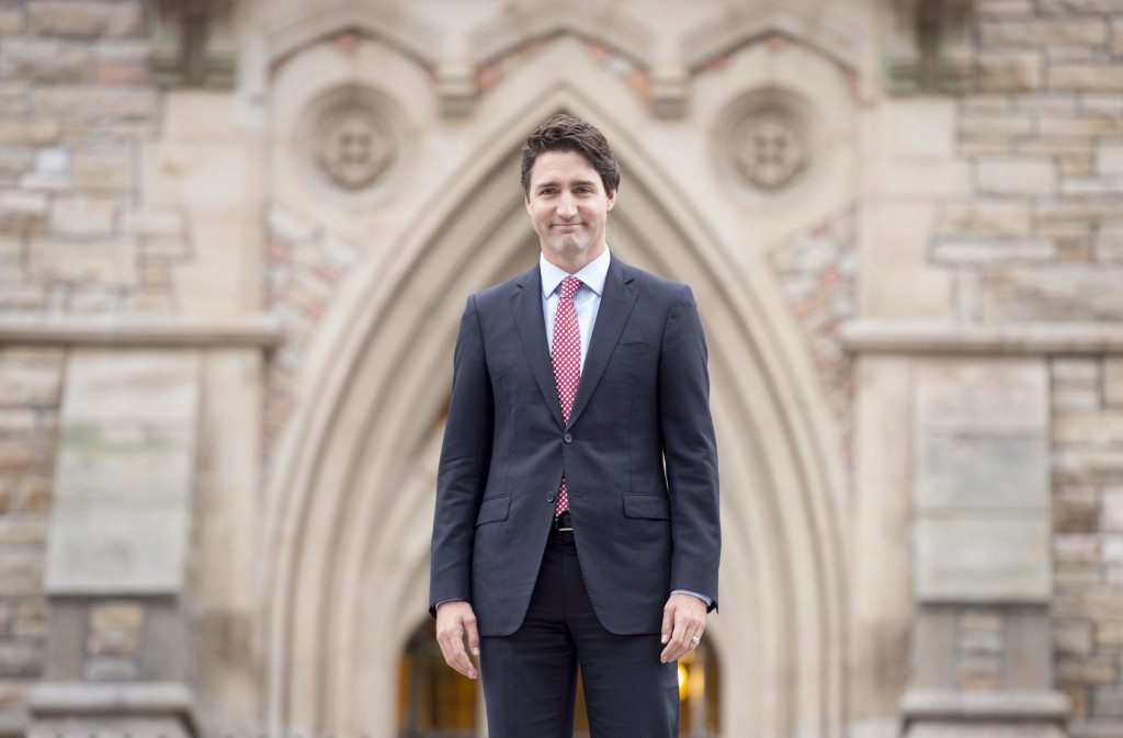 Prime minister-designate Justin Trudeau walks to a news conference from Parliament Hill in Ottawa on Oct. 20, 2015. Trudeau will be making trips to three international summits within his first month in office.The incoming prime minister is set to attend a G20 leaders' meeting in Turkey, an APEC summit in the Philippines, and climate talks in Paris starting later this month. (Adrian Wyld/CP)