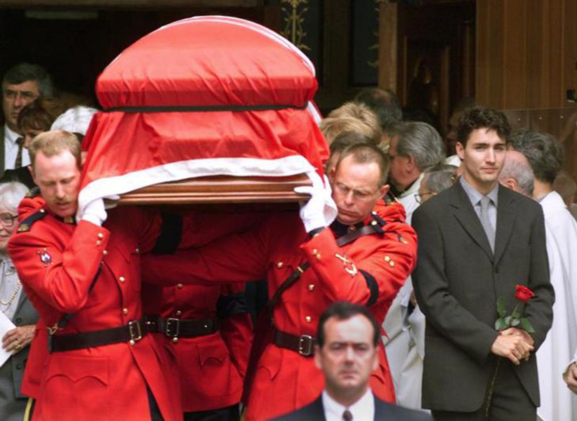 Justin Trudeau watches the casket of his father, former Canadian Prime Minister Pierre Trudeau, leave Notre Dame Basilica after his state funeral in Montreal October 3, 2000. Trudeau died September 28 at the age of 80. PJ/JP