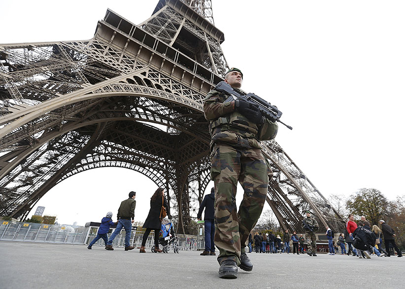 French military patrol near the Eiffel Tower the day after a series of deadly attacks in Paris , November 14, 2015.   (Yves Herman/Reuters)