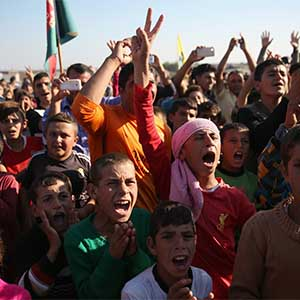 DEREK, SYRIA - NOVEMBER 13:  Yazidi refugees celebrate news of the liberation of their homeland of Sinjar from ISIL extremists, while at a refugee camp on November 13, 2015 in Derek, Rojava, Syria. Kurdish Peshmerga forces in Iraq say they have retaken Sinjar, with the help of airstrikes from U.S. led coalition warplanes. The Islamic State captured Sinjar in August 2014, killing many and sexually enslaving thousands of Yazidi women.  (John Moore/Getty Images)