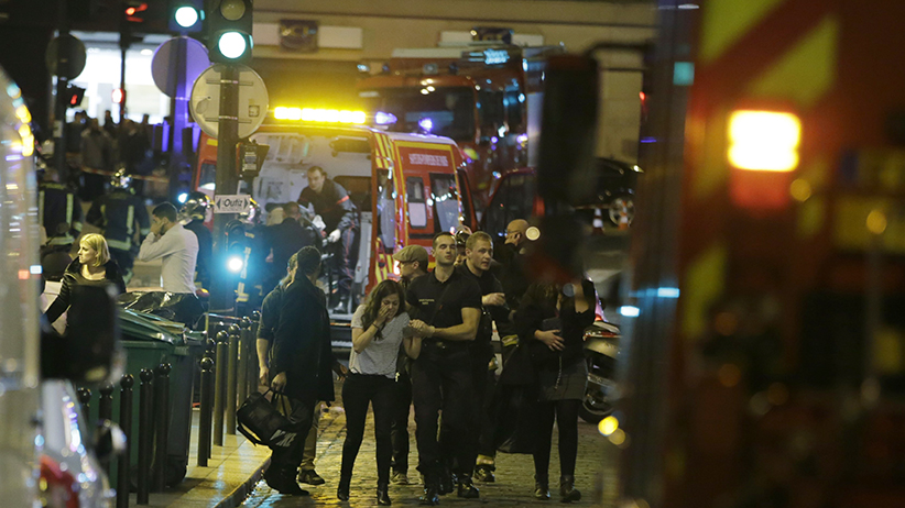 French security moves people in the area of Rue Bichat in the 10th arrondissement of the French capital Paris following a string of attacks on November 13, 2015. At least 18 people were killed as multiple shootings and explosions hit Paris, police said. Police also said there was an ongoing hostage crisis in the Bataclan a concert hall in the French capital. (KENZO TRIBOUILLARD/AFP/Getty Images)