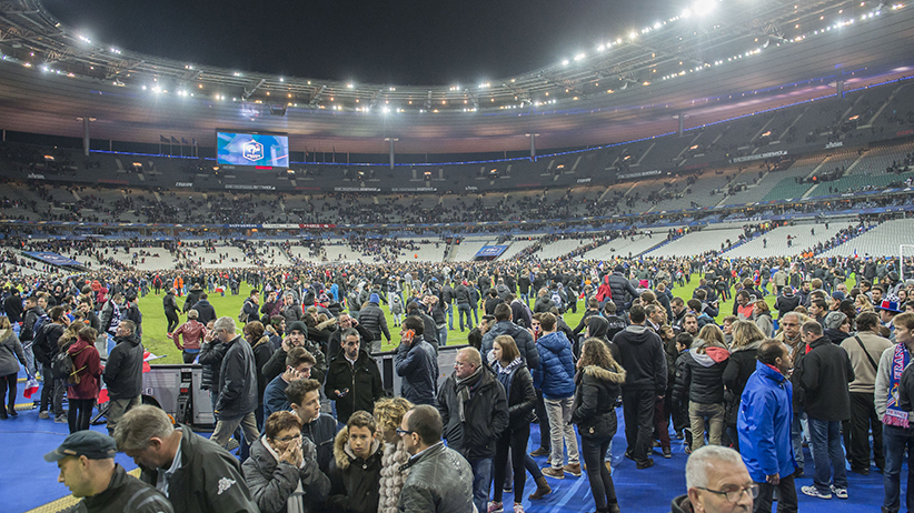 Attendees run in panic onto the pitch during the International friendly match between France and Germany on November 13, 2015 at the Stade France in Paris, France.(VI Images/Getty Images)