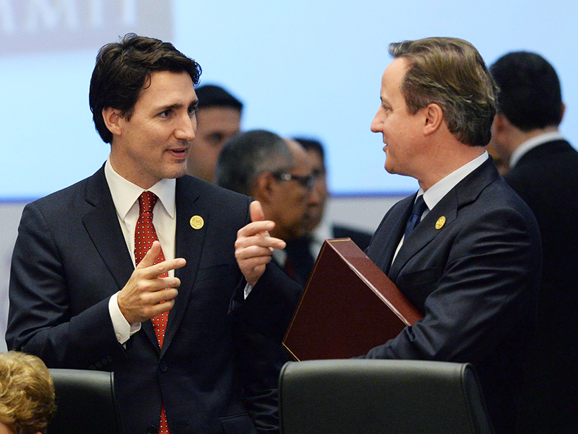Prime Minister Justin Trudeau talks to British Prime Minister David Cameron at the start of a plenary session at the G20 Summit in Antalya, Turkey on Sunday, Nov. 15, 2015. (Sean Kilpatrick/CP)