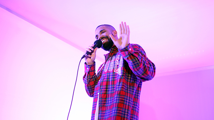 Toronto Rapper Drake addresses media in a 'Hotline Bling' installation at the Air Canada Centre in Toronto on November 25, 2015, prior to a Toronto Raptors vs. Cleveland Cavaliers NBA game. (Cole Burston/Toronto Star via Getty Images)