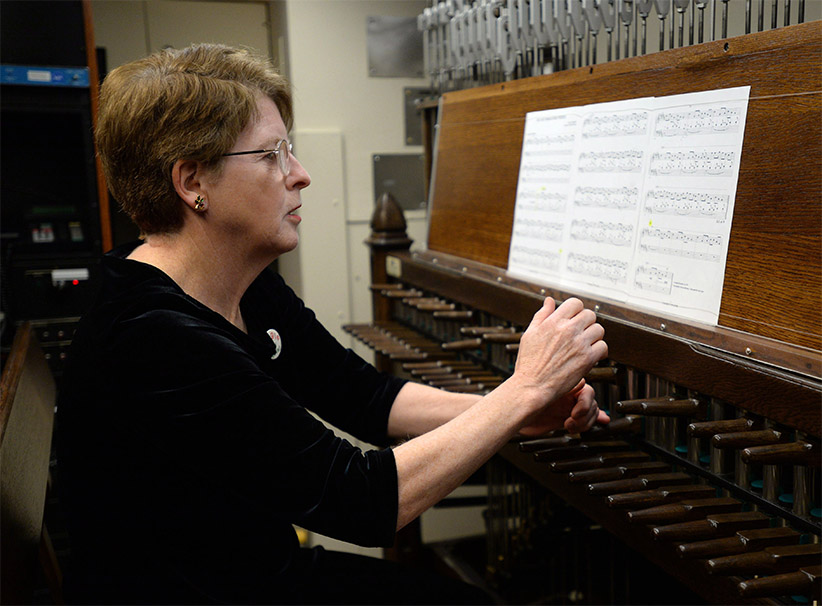 Dominion Carillonneur Dr. Andrea McCrady plays the Peace Tower Carillon on Parliament Hill in Ottawa on Friday, December 13, 2013. McCrady, who was named the Dominion Carillonneur in 2008, plays the Peace Tower Carillon every weekday at noon and on request. (Sean Kilpatrick/CP)