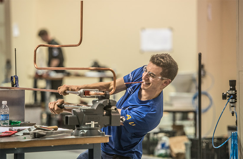An Australian competitor participates in the Plumbing and Heating competition at the 2015 WorldSkills Competiton in Sao Paolo. (WorldSkills International)