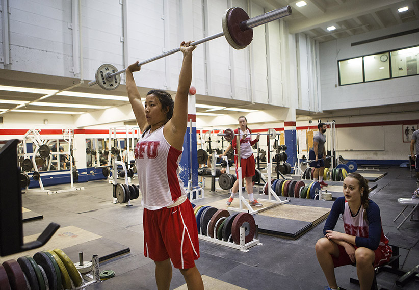 September 30, 2015 - BURNABY:  SFU basketball player Vanessa Gee (left) works out as fellow player Elisa Homer watches at Fraser University in Burnaby.  (Photograph by Della Rollins)
