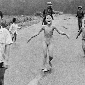 n this June 8, 1972, file photo, 9-year-old Kim Phuc, center, runs with her brothers and cousins, followed by South Vietnamese forces, down Route 1 near Trang Bang after a South Vietnamese plane accidentally dropped its flaming napalm on its own troops and civilians. The terrified girl had ripped off her burning clothes while fleeing.  Nick Ut/AP
