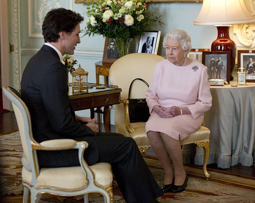 Prime Minister of Canada Justin Trudeau meets Britain's Queen Elizabeth II during a private audience at Buckingham Palace, London, Wednesday Nov. 25, 2015. (Yui Mok/PA/AP/CP)