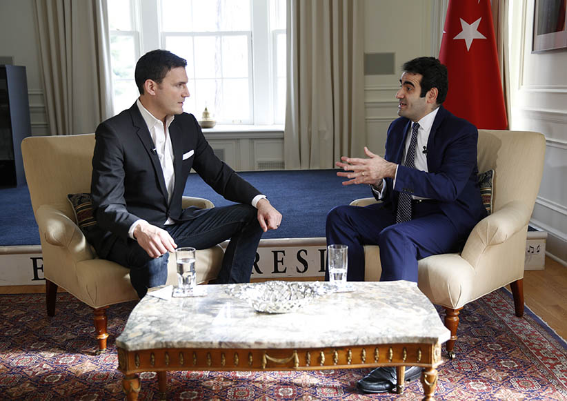 Evan Solomon speaking with Turkish Ambassador to Canada Selcuk Unal in Ottawa November 25, 2015. (Photograph by Blair Gable)