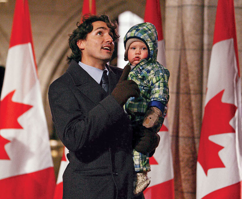 Justin Trudeau holds his son Xavier as they walk through  the main foyer following the Liberal caucus meeting on Parliament Hill on Wednesday, Nov. 19, 2008 prior to the speech from the throne.  Sean Kilpatrick/CP