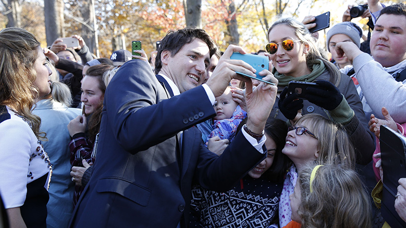 Prime Minister Justin Trudeau takes a selfie wih the crowds outside Rideau Hall after the Cabinet's swearing-in ceremony in Ottawa November 4, 2015. (Blair Gable/Reuters)