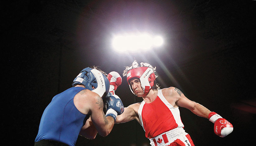 Liberal Member of Parliament Justin Trudeau (R) and Conservative Senator Patrick Brazeau fight during their charity boxing match in Ottawa March 31, 2012. REUTERS/Chris Wattie (CANADA - Tags: SPORT BOXING POLITICS)
